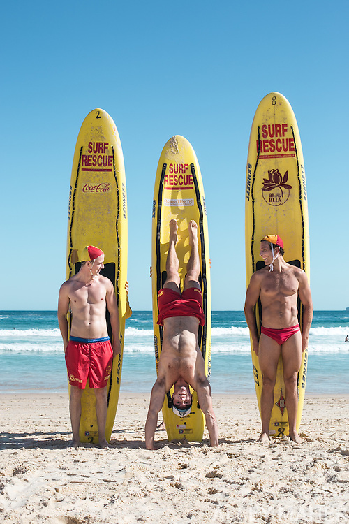 Three Australian Surf Rescue Life Guards Pose with Surf Boards at Bondi Beach.