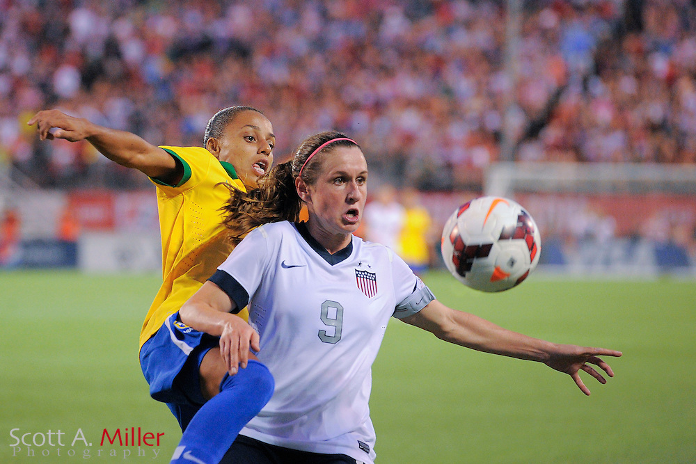 U.S. midfielder Heather O'Reilly (9) and Brazil forward Rilany (2) fight for a ball during an international friendly at the Florida Citrus Bowl on Nov. 10, 2013 in Orlando, Florida.  The U.S. won 4-1.<br /> <br /> <br /> &copy;2013 Scott A. Miller