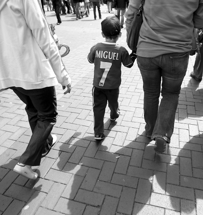 A young Chelsea fan walks towards Wembley stadium. FA Cup Final, Wembley Stadium, 20th May 2007.