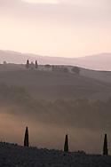 Early morning mist around the Chapel Vitaleta, Val d'Orcia, Tuscany, Italy