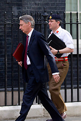 © Licensed to London News Pictures. 23/05/2013. London, UK. The Defence Secretary, Philip Hammond, arrives at Number 10 Downing Street in London today (23/05/2013) ahead of a meeting of COBRA (Cabinet Office Briefing Room A) to discuss yesterday's alleged terrorist attack in Woolwich.. Photo credit: Matt Cetti-Roberts/LNP