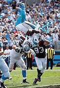Carolina Panthers quarterback Cam Newton (1) flies into the end zone after a hit by Houston Texans free safety Rahim Moore (26) as he goes head over heels into the end zone on a 2 yard touchdown run good for a 17-10 third quarter lead during the 2015 NFL week 2 regular season football game against the Houston Texans on Sunday, Sept. 20, 2015 in Charlotte, N.C. The Panthers won the game 24-17. (©Paul Anthony Spinelli)