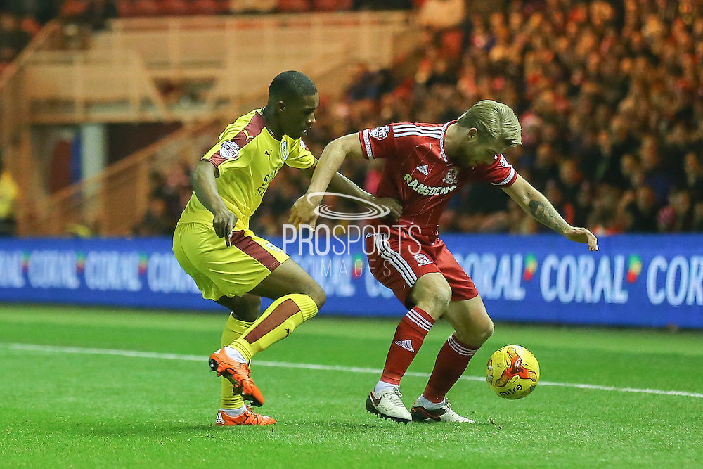 Middlesbrough midfielder Adam Clayton  tackles Burnley defender Tendayi Darikwa  during the Sky Bet Championship match between Middlesbrough and Burnley at the Riverside Stadium, Middlesbrough, England on 15 December 2015. Photo by Simon Davies.