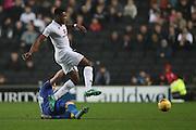Milton Keynes Dons midfielder Chuks Aneke (25) evades a challenge during the EFL Sky Bet League 1 match between Milton Keynes Dons and AFC Wimbledon at stadium:mk, Milton Keynes, England on 10 December 2016.