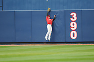 A ball hit by Mississippi's David Phillips clears the fence over Louisville centerfielder Drew Haynes at Oxford-University Stadium in Oxford, Miss. on Saturday, March 13, 2010. Phillips was called out when he passed baserunner Zach Miller after unpires didn't make a call on the hit. Ole Miss won 8-3.