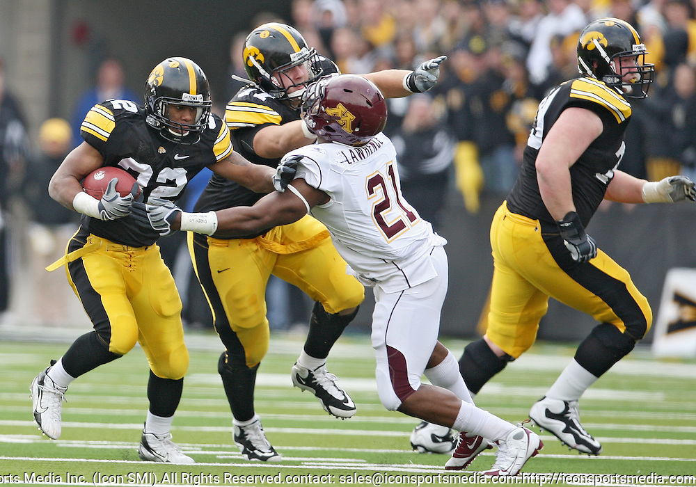 November 21, 2009: Iowa running back Adam Robinson (32) tries to get around Minnesota linebacker Simoni Lawrence (21) during the first half of the Iowa Hawkeyes 12-0 win over the Minnesota Golden Gophers at Kinnick Stadium in Iowa City, Iowa on November 21, 2009.