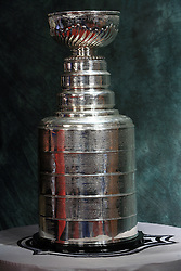 The Stanley Cup (French: La Coupe Stanley), awarded annually to the National Hockey League (NHL) champion, is the most coveted ice hockey club championship trophy in the world. It is commonly referred to as The Cup, The Holy Grail, or facetiously as Lord Stanleys Mug.The Stanley Cup is surrounded by numerous legends and traditions, the oldest of which is the celebratory drinking of champagne out of the cup by the winning team. Unlike the trophies awarded by the other three major professional sports leagues of North America, a new Stanley Cup is not made each year; Cup winners keep it until a new champion is crowned. It is the only trophy in professional sports that has the name of the winning players, coaches, management, and club staff engraved on it. The original bowl was made of silver and has a dimension of 18.5 cm (7.28 inches) in height and 29 cm (11.42 inches) in diameter. The current Stanley Cup is made of silver and nickel alloy. It has a height of 89.54 cm (35.25 inches) and weighs 15.5 kg (34.5 lb).The Stanley Cup is the oldest professional sports trophy in North America. It was presented in Nova Scotia Sport Hall of Fame, when Ice-Hockey IIHF WC 2008 was in Halifax,  on May 11, 2008 in Metro center, Halifax, Canada.  (Photo by Vid Ponikvar / Sportal Images)