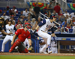 March 12, 2017 - Miami, FL, USA - United States left fielder Christian Yelich hits a single during the second inning of a World Baseball Classic first round Pool C game against Canada on Sunday, March 12, 2017 at Marlins Park in Miami, Fla. (Credit Image: © David Santiago/TNS via ZUMA Wire)