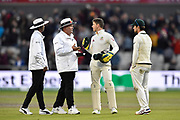Tim Paine of Australia talks to the umpires as play is stopped for bad light during the International Test Match 2019, fourth test, day three match between England and Australia at Old Trafford, Manchester, England on 6 September 2019.