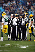 NFL officials huddle and discuss a fumble during the Carolina Panthers 2017 NFL week 15 regular season football game against the Green Bay Packers, Sunday, Dec. 17, 2017 in Charlotte, N.C. The Panthers won the game 31-24. (©Paul Anthony Spinelli)