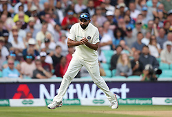 India's Mohammed Shami catches the ball to take the wicket of England's Jos Buttler during the test match at The Kia Oval, London.