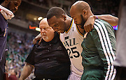 Jazz center Al Jefferson (25) is brought off the court after going down with a back injury during the second half of the NBA basketball game between the Utah Jazz and the Orlando Magic at Energy Solutions Arena, Wednesday, Dec. 5, 2012.