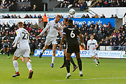 Oli McBurnie (9) of Swansea City has his shirt ripped by John O'Shea (4) of Reading as they battles for possession during the EFL Sky Bet Championship match between Swansea City and Reading at the Liberty Stadium, Swansea, Wales on 27 October 2018.