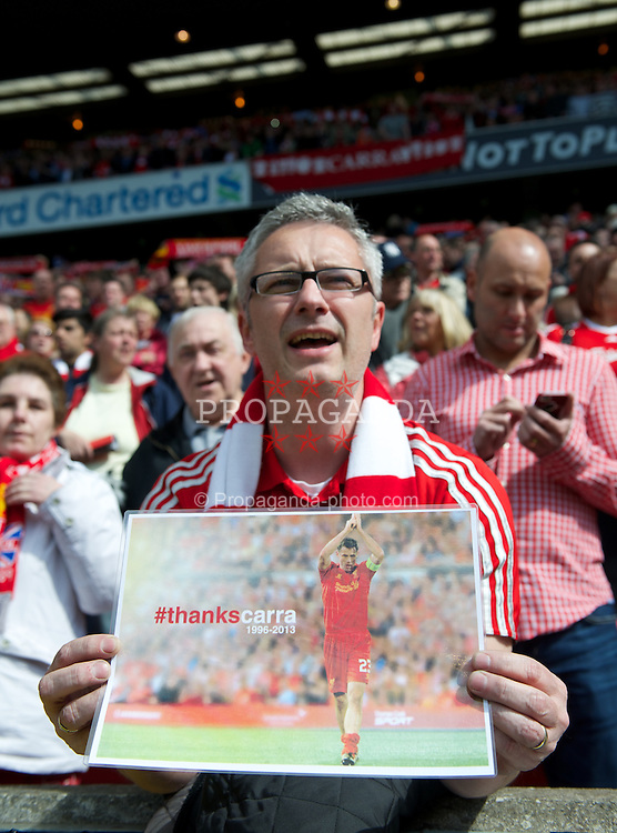 LIVERPOOL, ENGLAND - Sunday, May 19, 2013: A Liverpool supporter salutes Jamie Carragher before the final Premiership match of the 2012/13 season against Queens Park Rangers at Anfield. (Pic by David Rawcliffe/Propaganda)