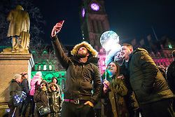 © Licensed to London News Pictures . 31/12/2017. Manchester, UK. Thousands gather to watch as Manchester celebrates the start of 2018 , with a fireworks display in front of the Town Hall in Albert Square . This year's celebration sees additional security, including concrete barriers around the square and bag searches and the event includes a poetry reading by Tony Walsh , in memory of those who were killed at a terrorist attack after at the Manchester Arena in May 2017. Photo credit: Joel Goodman/LNP