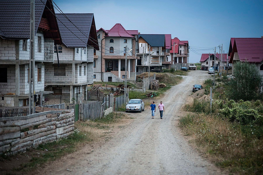 A road in the village of Cajvana lined with new houses being build by people who have made their money abroad, mainly in the construction industry.