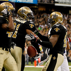 January 1, 2012; New Orleans, LA, USA; New Orleans Saints cornerback Patrick Robinson (21) celebrates with teammates safety Roman Harper (41) and safety Isa Abdul-Quddus (42) following an interception during the second quarter of a game against the Carolina Panthers at the Mercedes-Benz Superdome. Mandatory Credit: Derick E. Hingle-US PRESSWIRE