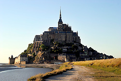 FRANCE MONT ST. MICHEL 28AUG05 - General view of the monastery of Mont Saint Michel seen from the causeway. Since the eleventh century, buildings have been added to the island's original church to produce a fortified hotch-potch of Romanesque and Gothic architecture, forming probably the most recognisable silhouette in France after the Eiffel Tower...jre/Photo by Jiri Rezac..© Jiri Rezac 2005..Contact: +44 (0) 7050 110 417.Mobile:  +44 (0) 7801 337 683.Office:  +44 (0) 20 8968 9635..Email:   jiri@jirirezac.com.Web:     www.jirirezac.com..© All images Jiri Rezac 2005 - All rights reserved.