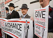"Picture by Mark Larner. Picture shows chaps gathered outside Abercrombie & Fitch's London store to protest against the proposed opening of an A&F store on Savile Row, the centuries old home of bespoke tailoring. 23/04/2012..Press release from The Chap Magazine:-.""On Monday, 23rd April 2012 (St Georges Day) several hundred immaculately dressed Chaps and Chapettes will gather outside number 3, Savile Row, to protest in the strongest possible terms against the opening of a childrens clothes shop there by Abercrombie & Fitch.The Chap feels that this city is already overwhelmed with American-style chain stores selling overpriced T-shirts and hooded sporting garments for those who rarely do any sport. Savile Row has been the home of gentlemens bespoke tailoring for over 200 years, and the opening of this store would signal the end of this one little street being allowed to devote itself to a single trade.""."