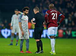 LONDON, ENGLAND - Monday, February 4, 2019: Liverpool's Mohamed Salah (L) speaks with referee Kevin Friend during the FA Premier League match between West Ham United FC and Liverpool FC at the London Stadium. (Pic by David Rawcliffe/Propaganda)