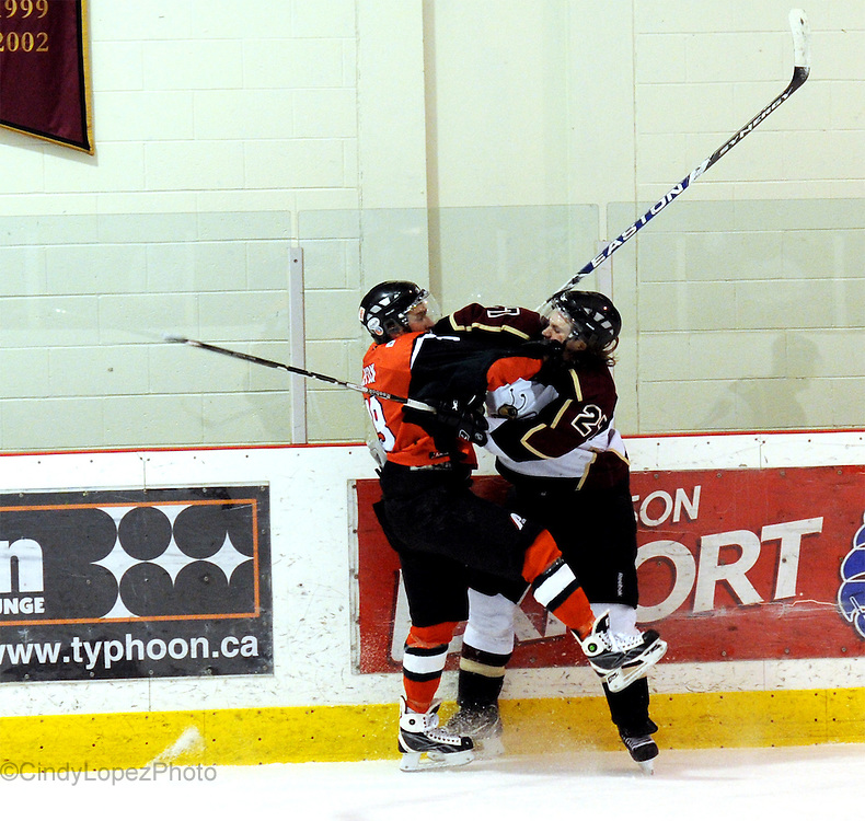 Concordia Stingers Defenseman Lyle Van Wieren takes a hit during game 2 against UQTR in the OUA Playoffs. February 2010.