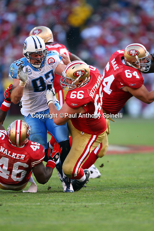Tennessee Titans defensive end Kyle Vanden Bosch (93) gets double teamed by San Francisco 49ers center Eric Heitmann (66) and tight end Delanie Walker (46) during the NFL football game against the San Francisco 49ers, November 8, 2009 in San Francisco, California. The Titans won the game 34-27. (©Paul Anthony Spinelli)