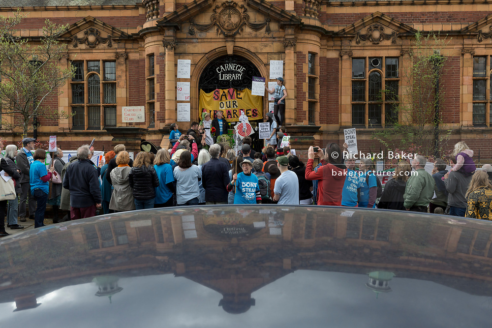 On the first anniversary of the closure by Lambeth Council of carnegie Library in Herne Hill in south London, angry protesters gather on the steps of the Edwardian community building, vacant and awaiting its conversion to a gym, on 1st March 2017, in London, England.