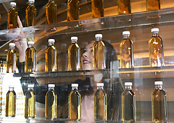 EMBARGOED: 00.01 TUE 22052018;  Alison Warrender, a communications associate at the new Macallan distllery on Speyside examines some of the 3,000 bottles displayed in the natural colour wall. Pic copyright Terry Murden @edinburghelitemedia.  EMBARGOED: 00.01 TUE 22052018