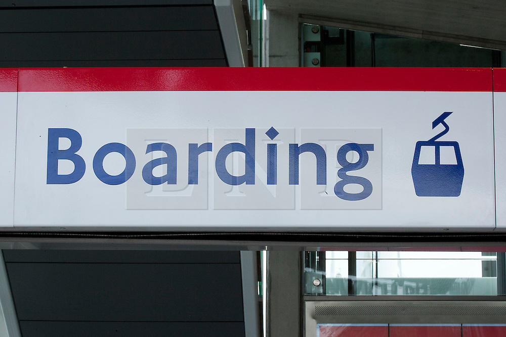 © Licensed to London News Pictures. 28/06/2012. LONDON, UK. A boarding sign showing an Emirates Air-Line cabin is at the Greenwich Peninsula terminal in East London today (28/06/12) at the launch of London's first cable car system. The new cable car system, running across the River Thames between the Greenwich Peninsula and the Royal Docks in East London, was today opened to the public, despite fears that it would not be ready in time for the London 2012 Olympics. Photo credit: Matt Cetti-Roberts/LNP