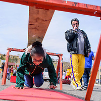 040415       Cable Hoover<br /> <br /> Ariel Jones makes her way through an obstacle course under the guidance of Dennis Romero at a fitness station sponsored by Wowie's Gym at the Spring Fling at For Canyon Park in Gallup Saturday.