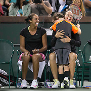 March 7, 2015, Indian Wells, California:<br /> Jagger leach hugs his mother, Lindsay Davenport, alongside Madison Keys after playing a point during the McEnroe Challenge for Charity presented by Masimo in Stadium 2 at the Indian Wells Tennis Garden in Indian Wells, California Saturday, March 7, 2015.<br /> (Photo by Billie Weiss/BNP Paribas Open)