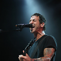 Sully Erna of the rock band Godsmack, sings during his performance at the Rockstar Energy Drink Uproar festival at the 1-800-Ask-Gary amphitheater in Tampa, Florida on Thursday, September 13, 2012. (AP Photo/Alex Menendez)