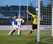 Ewan Falconer scores for Grove Academy (white) against St Johns (blue) in the Under 15s Senior Sports Cup Final at Dens Park<br /> <br /> <br />  - &copy; David Young - www.davidyoungphoto.co.uk - email: davidyoungphoto@gmail.com