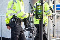 © Licensed to London News Pictures . 20/10/2018 . Manchester , UK . A police drone , used to monitor the protest , crashes to the ground and smashes in Piccadilly Gardens and has to be carried away . Street protest movement , the English Defence League ( EDL ) , hold a demonstration , opposed by anti-fascists , including Unite Against Fascism ( UAF ) , in Manchester City Centre . Amongst the reasons for their protest , the EDL cite news reports that revealed an imam at the Didsbury Mosque where Manchester Arena bomber Salman Abedi prayed , praised armed jihad in a sermon delivered just days before Abedi bought a ticket for the Ariana Grande concert at which he killed twenty two people . Photo credit : Joel Goodman/LNP
