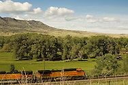Burlington Northern Santa Fe Train passes Sheep Mountain east of Livingston, Montana