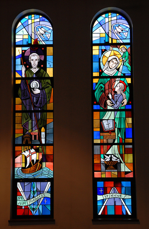 Two stained glass panels inside Our Lady Queen of Peace Church in Milwaukee depict St. Jude Thaddeus and St. Anne. (Photo by Sam Lucero)