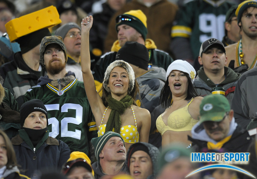 Dec 11, 2011; Green Bay, WI, USA; Green Bay Packers female fans cheer during the game against the Oakland Raiders at Lambeau Field. The Packers defeated the Raiders 46-16.