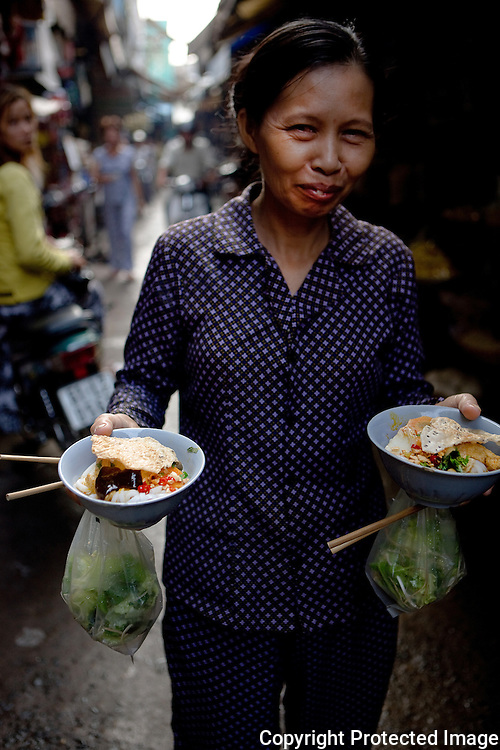 making a noodle delivery, ho chi minh city, vietnam