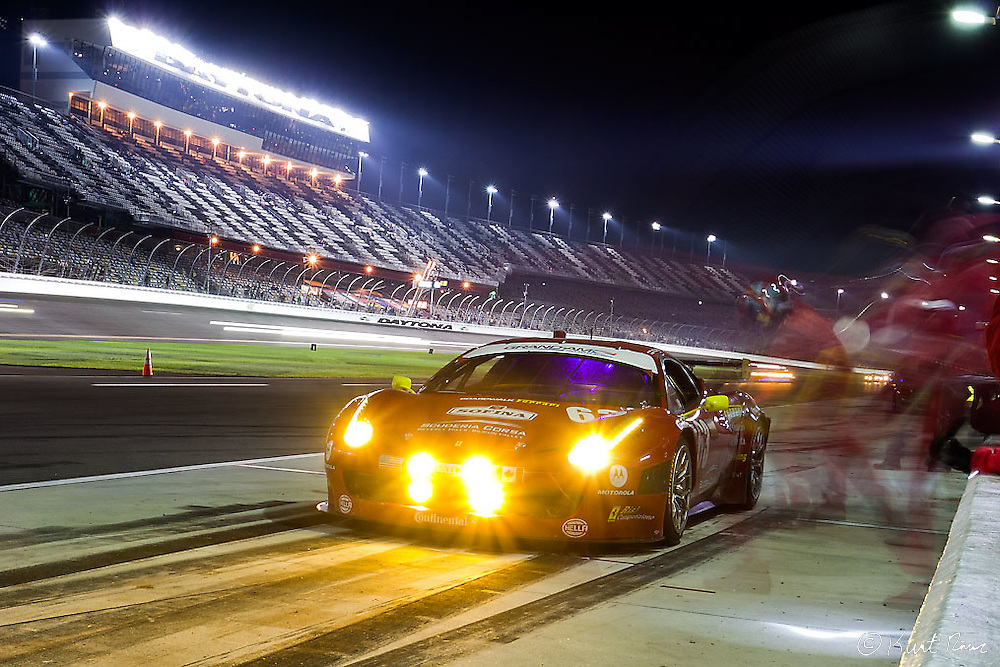 The No. 63 Risi Competizione Ferrari 458 pits at night during the Rolex 24 Hour Race at Daytona International Speedway in Daytona Beach, FL on January 28, 2012.