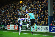 Derby County striker Darren Bent (11) heads clear of Queens Park Rangers defender Jake Bidwell (3) during the EFL Sky Bet Championship match between Queens Park Rangers and Derby County at Loftus Road, London, England on 14 December 2016. Photo by Jon Bromley.