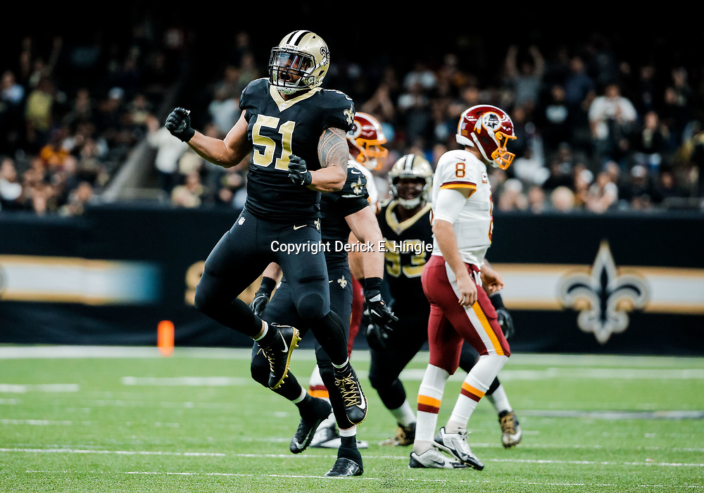 Nov 19, 2017; New Orleans, LA, USA; New Orleans Saints linebacker Manti Te'o (51) celebrates a defensive stop during the fourth quarter of a game against the Washington Redskins at the Mercedes-Benz Superdome. The Saints defeated the Redskins 34-31 in overtime. Mandatory Credit: Derick E. Hingle-USA TODAY Sports