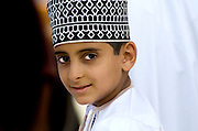 Young Omani boys Nizwa.<br /> Oman is one of the more traditional countries in the Gulf region, situated on the southeast coast of the Arabian Peninsula at the entrance to the Persian Gulf with a population of around 3 million, though predominantly Arab Omani people are ethnically diverse and reflect its tribal Bedouin and sea faring culture and history.