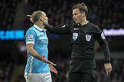 The referee points to the spot after Raheem Sterling (Manchester City) is deemed to have handled the ball in the penalty box during the Barclays Premier League match between Manchester City and Tottenham Hotspur at the Etihad Stadium, Manchester, England on 14 February 2016. Photo by Mark P Doherty.