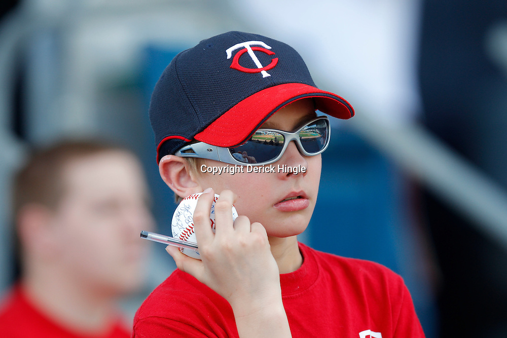 February 28, 2011; Fort Myers, FL, USA; A young Minnesota Twins fan holds an autographed ball during a spring training exhibition game against the Boston Red Sox at City of Palms Park.  Mandatory Credit: Derick E. Hingle