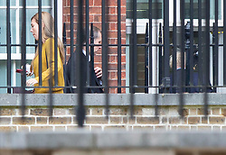 © Licensed to London News Pictures. 12/08/2019. London, UK. Prime Minister Boris Johnson (r) and his  girlfriend Carrie Symonds (l) arrive at the back of Downing Street. Later today the Prime Minister will host senior police, justice and probation officials. Photo credit: George Cracknell Wright/LNP