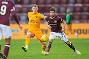 Gregg Wylde (#39) of Livingston FC and Benjamin Garuccio (#17) of Heart of Midlothian fight for the ball during the 4th round of the William Hill Scottish Cup match between Heart of Midlothian and Livingston at Tynecastle Stadium, Edinburgh, Scotland on 20 January 2019.