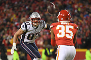 Jan 20, 2019; Kansas City, MO, USA; New England Patriots tight end Rob Gronkowski (87) watches his tipped catch intercepted by Kansas City Chiefs cornerback Charvarius Ward (35) for a play, which was later called back during the AFC Championship game at Arrowhead Stadium. The Patriots defeated the Chiefs 37-31 in overtime to advance to their fifth Super Bowl in eight seasons. (Robin Alam/Image of Sport)