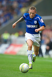 CARDIFF, ENGLAND - Saturday, August 10, 2010: Cardiff City's Craig Bellamy in action against Doncaster Rovers on his debut during the Football League Championship match at the Cardiff City Stadium. (Pic by: David Rawcliffe/Propaganda)
