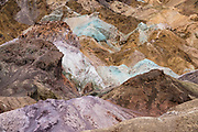 Artist's Palette geologic formation on Artists Drive, Death Valley National Park, California, USA. More than 5 million years ago, multiple volcanic eruptions deposited ash and minerals across the landscape, which chemically altered over time into a colorful paint pot of elements: iron, aluminum, magnesium, and titanium.