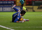 Leeds United goalkeeper Marco Silvestri having to make a rare save during the Sky Bet Championship match between Charlton Athletic and Leeds United at The Valley, London, England on 12 December 2015. Photo by Matthew Redman.